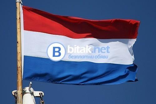 Работници на поточна линия – централна Холандия