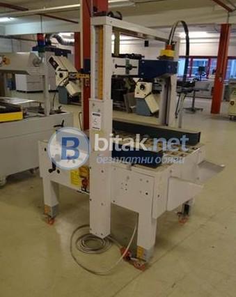 Автоматична машина за запечатване на кашони с тиксо - долно и странично задвижване на продукта
