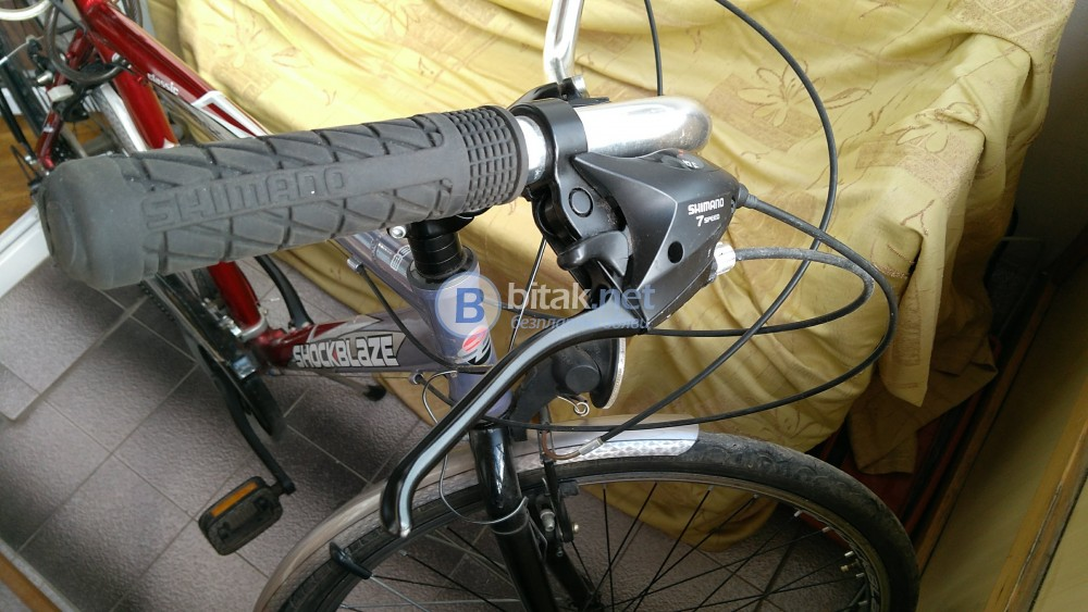 Продавам градски велосипед марка SHOCKBLAZE ,алуминиева рамка
